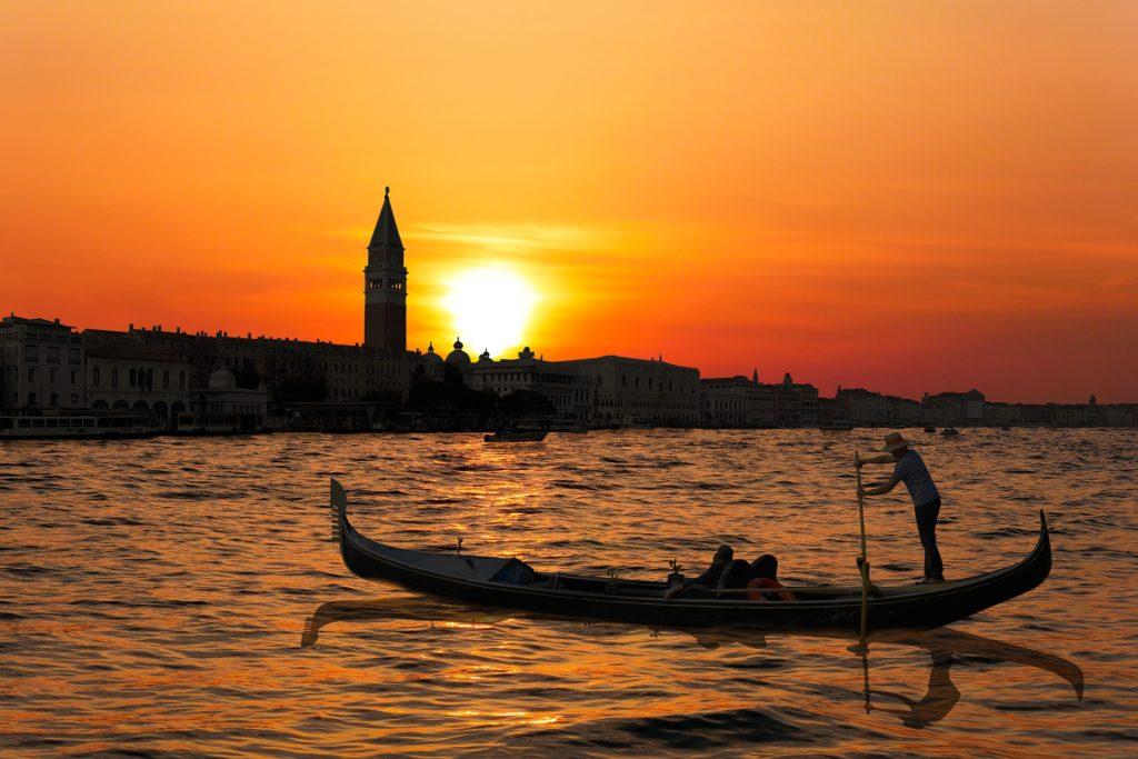 Venice night gondola ride photo