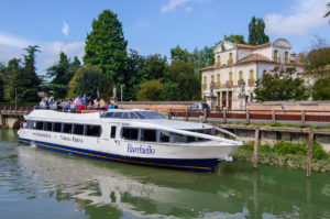Cruise boat along Brenta river